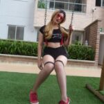 teen tranny playing on swing